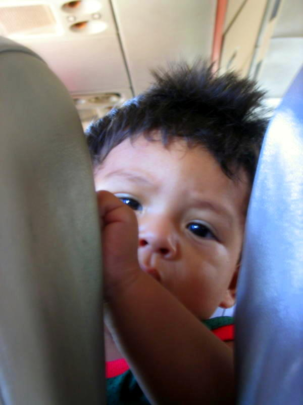 """A little cutie on the """"chicken bus"""" in Central America."""