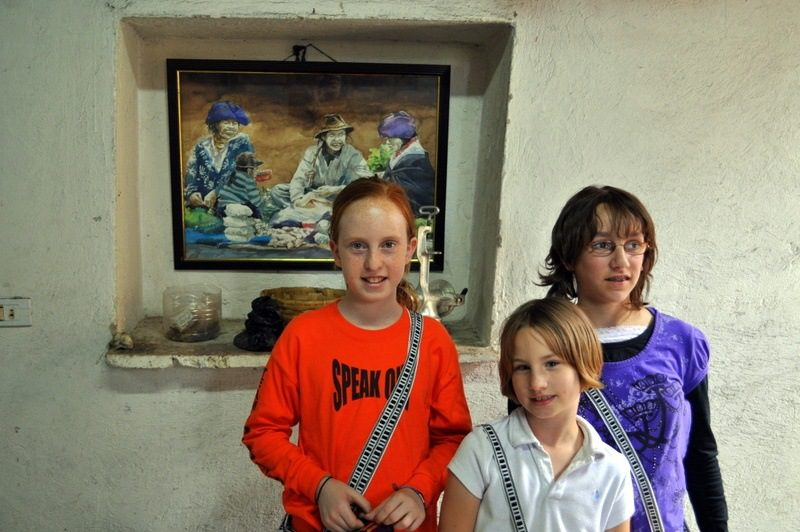 10 year old students explore Ecuador's weaving cottages.