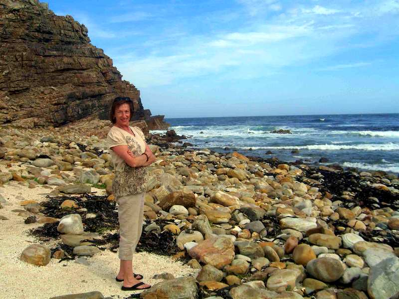 Bill's wife standing at the Cape of Good Hope.