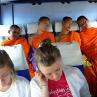 Monks and Randy's daughter on a Thailand bus!