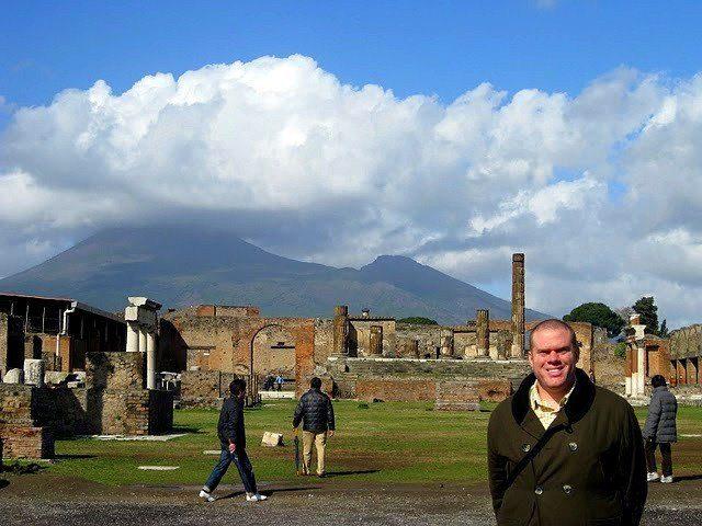 In Pompeii, Italy, with Mt. Vesuvius in the background.