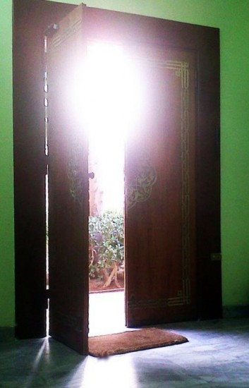 Sun shines through a door in Cairo.