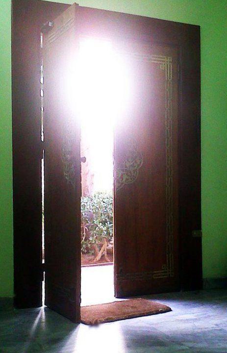 Sun shines through a door in Cairo.