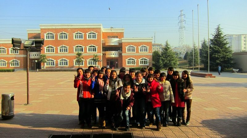 Students pose outside in the Xi'an sunlight.