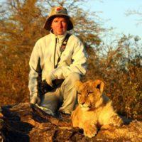 Michael and 8 mo. old female lion, Antelope Park, Zimbabwe