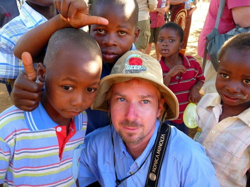 Michael surrounded by new friends in Mozambique