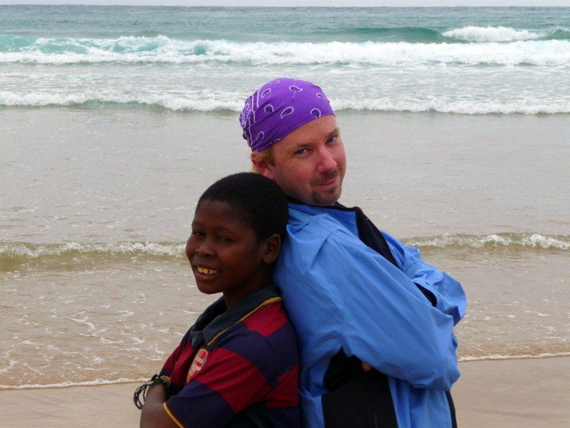 With a local friend by the Indian Ocean in Mozambique.