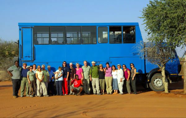 Peggy's GEEO group, travel truck, and Zimbabwean guides.