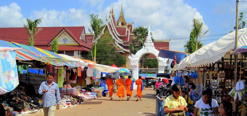 Orange-clad monks in beautiful Vientiane, Laos.