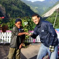 Brad with a happy student in Nepal!