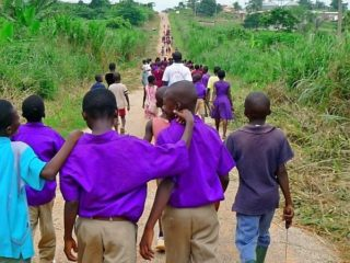 Ghana students returning from rain forest planting.