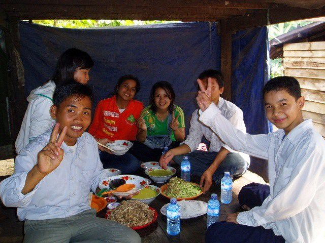 Some of Nikki's students invited her to their home for a small class party in the countryside for traditional Cambodian rice noodles and fresh young coconuts, July 2007.