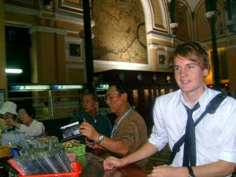 Sending a poscard in Ho Chi Minh City's famous post office.