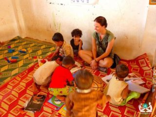 Elaine Playing With Preschoolers In Cambodia.