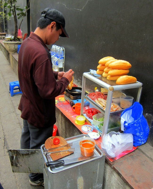 One of many street baguette vendors in Hanoi, Vietnam. Delicious , nutritious and ubiquitous!
