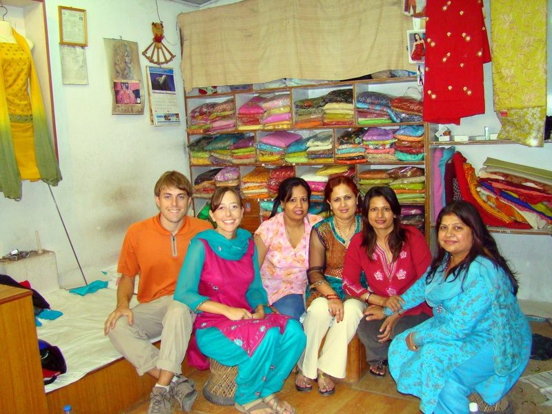 Jacob shopping for teacher clothes (salwar kurta) with his wife with their amma from their home stay.