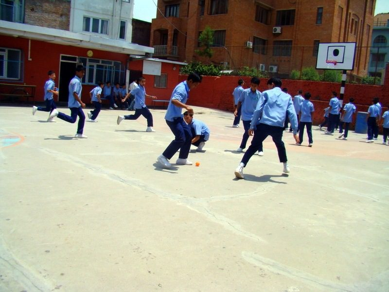 Soccer in the sun-scorched courtyard between classes.