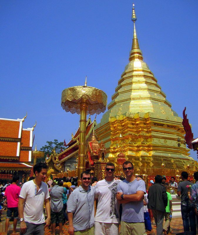 Mike and his brother and cousin visiting Doi Suthep temple in Chang Mai, Thailand, on Songkran. A very reverent ceremony.