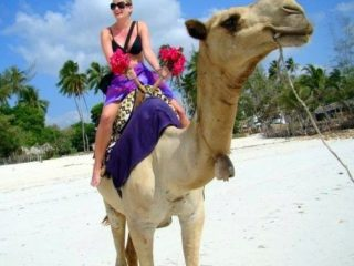 Lisa, seeing what all the camel-riding fuss is about in Mombasa. She reports: