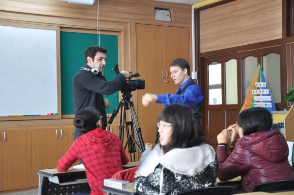 Murat and Steventeacher set up for a shot in South Korea while the students get ready for another take.