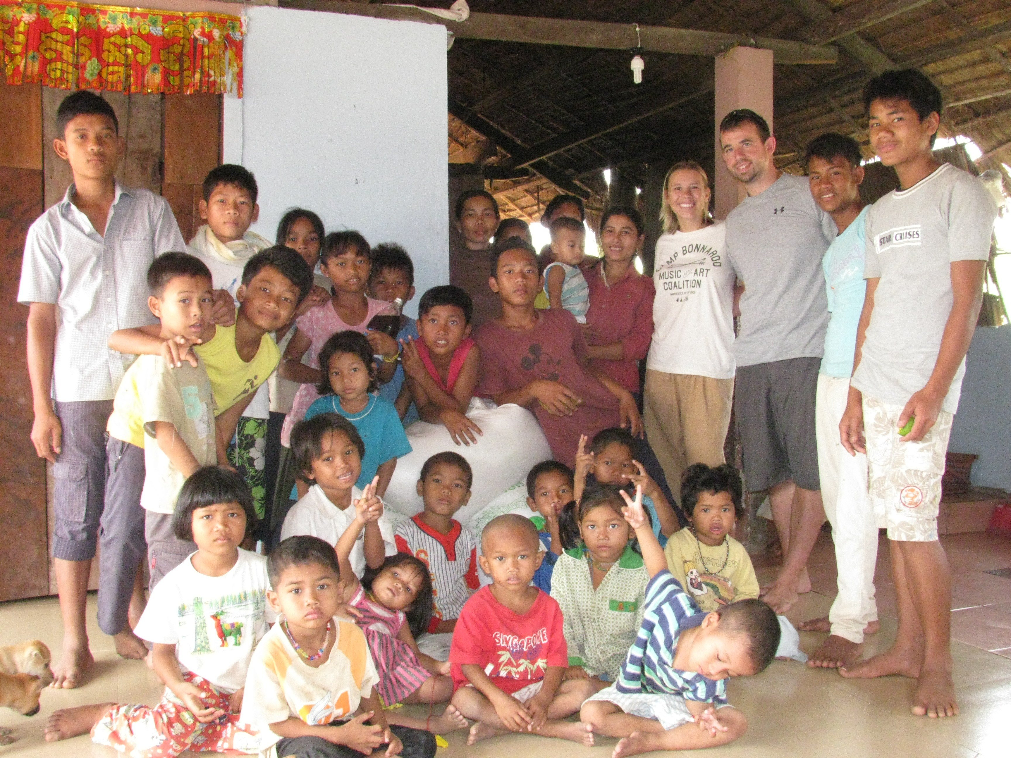 Tim and Robin with the welcoming community in Siem Reap.