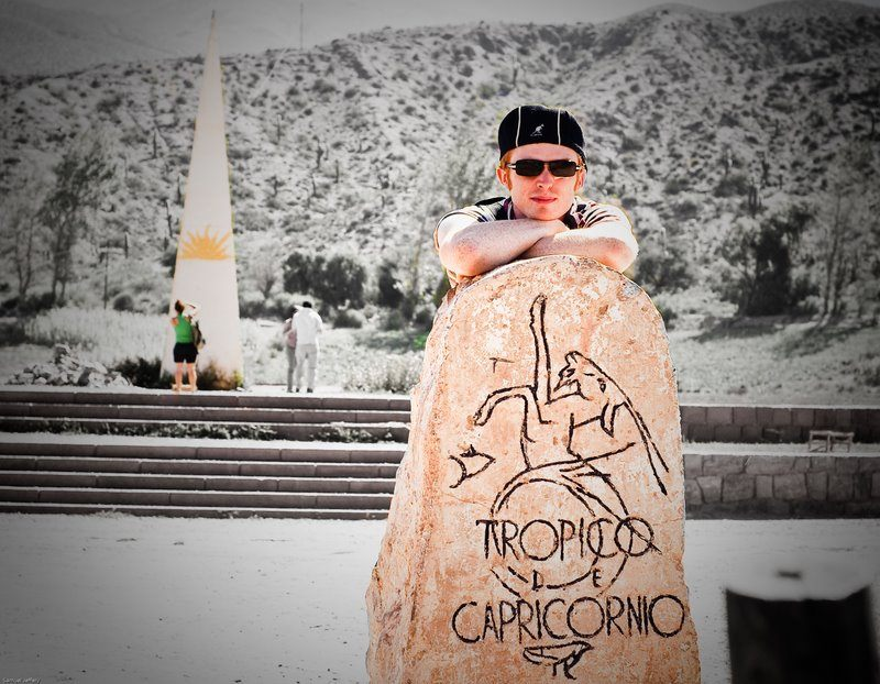 Samuel posing at the Tropic of Capricorn.