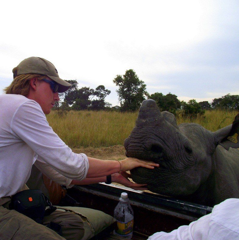 James feeding a Rhino in Zimbabwe. Wow!!!