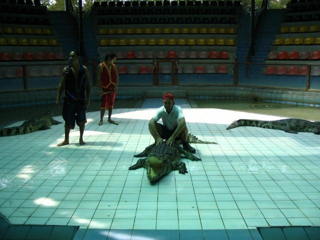 Posing with a crocodile during his travels. Dramatic photo!