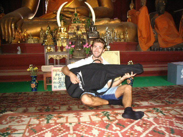 In a beautiful Wat (temple)... with a guitar!