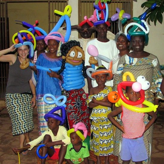 Sara with her balloon animal creations and host family in Mali!