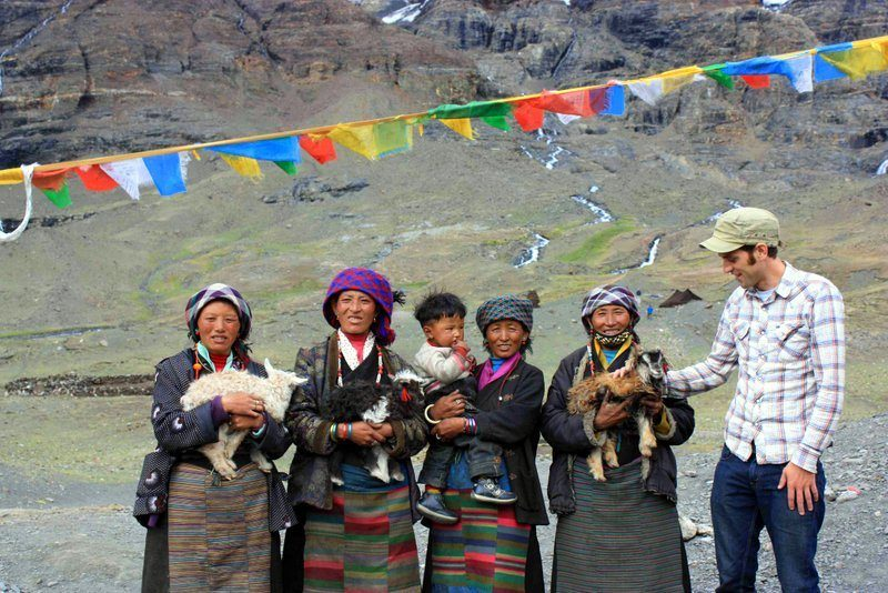 Chris with new friends during Tibet travel.