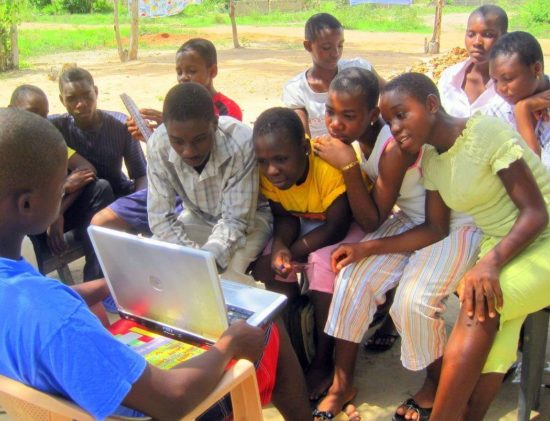 My students in Ghana reading a blog article I wrote about them!
