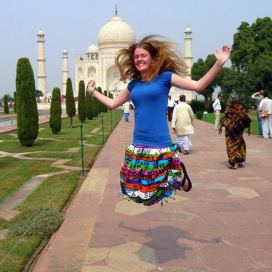Chelsea, jumping for joy at the Taj Mahal, India.