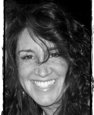 Gretchen, smiling through Iraq teaching intensity.
