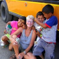 Donna making friends with kids during teaching and travel in Nicaragua.