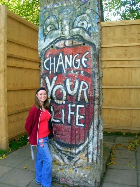 Mandy in front of a section from the Berlin wall that came from an area near the Brandenburg Gate and was acquired by Britain's Imperial War Museum in 1991.