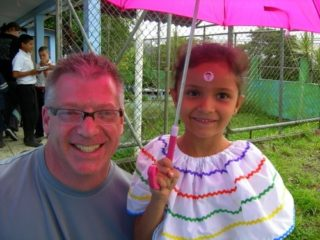 Scott with a young student during Costa Rica travel.
