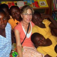 Sue with her students during amazing summer Ghana volunteer travel.
