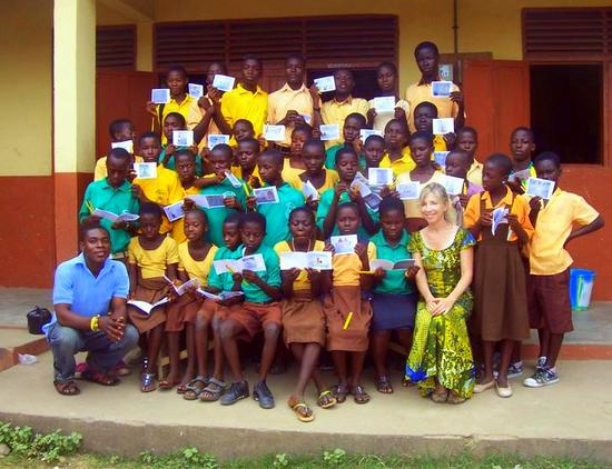 Sue in a beautiful dress with her class at Bantuma, Ghana.