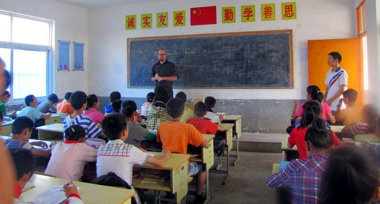 Chris in the classroom during his time teaching abroad in China, while not getting punched in the face.
