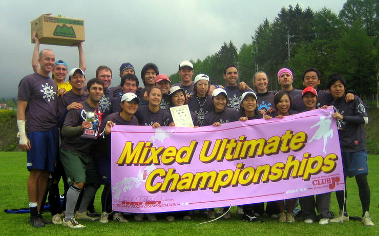 2010 Japan Mixed Nationals Champions. (The box raised high contains the prize: lettuce!)