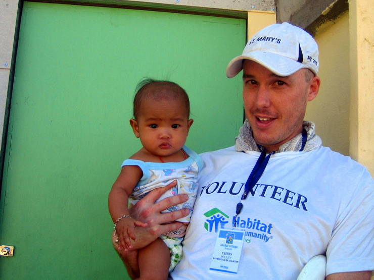 Chris and a new friend during Habitat for Humanity in the Philippines.