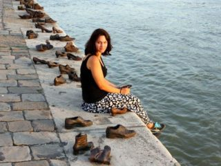 Sarah with shoe statues on the Danube River in Budapest, Hungary.