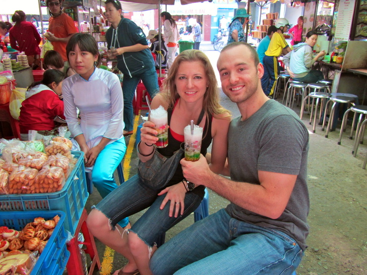 Maggie and her husband enjoying the drink Chè at a market in Saigon, Vietnam.