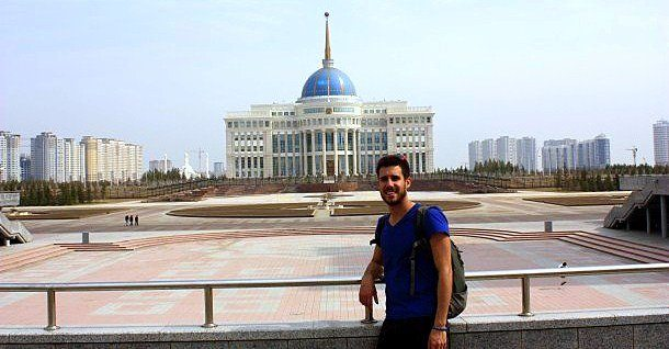 Ian posing in front of presidential palace in the futuristic city of Astana, Kazakhstan.