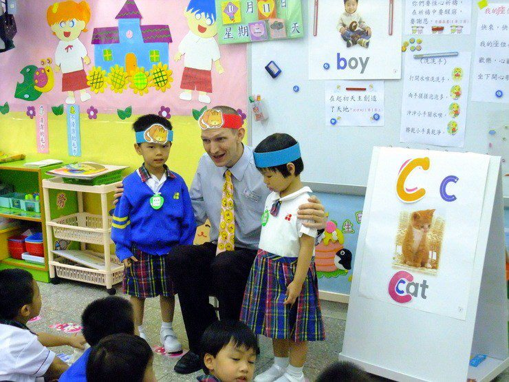 Jonny teaching English in Hong Kong. What a cute photo!