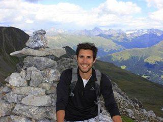 Ian summiting a mountain in Arosa, Switzerland.