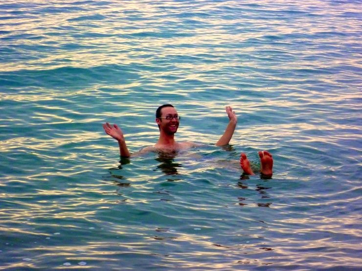 Sam floating in the Dead Sea, Jordan.