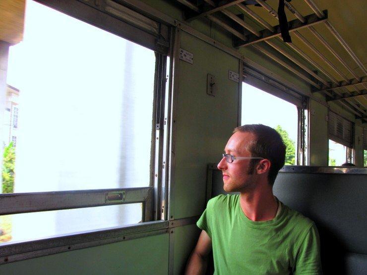 Sam on a train in Thailand.