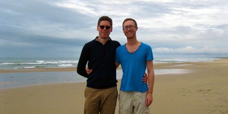 Zab and Sam on a beach in Uruguay.